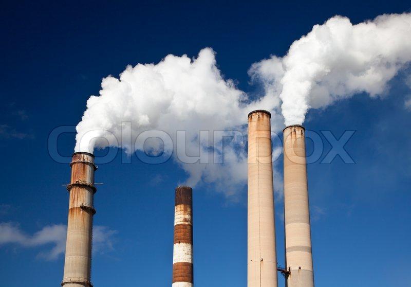 White Smoke Out Of Industrial Smokestack Stock Photo