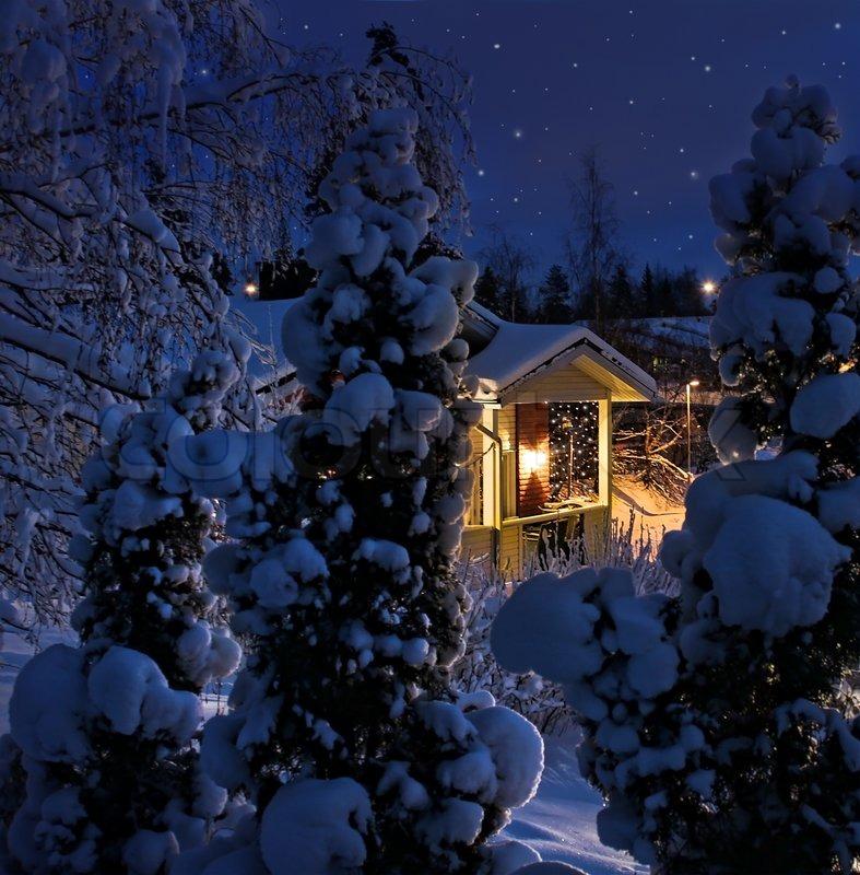 3d Snowy Cottage Animated Wallpaper Windows 7 Illuminated House On Snowy Christmas Evening Stock Photo