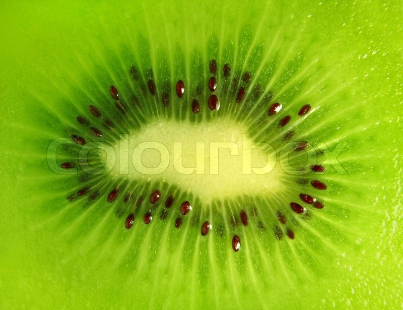 Close up of a kiwi fruit inside with seeds stock photo