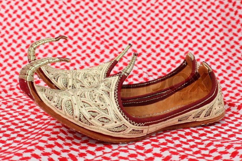 Traditional Oriental Shoes Over Arabic Cloth Stock Photo