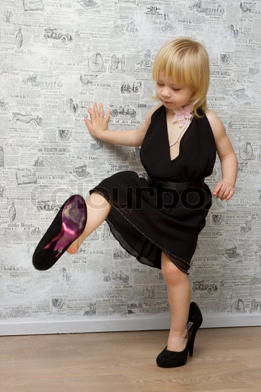 Cute Stylish Child Girl Wallpaper The Little Girl Measures The Mother S Shoes With Heels
