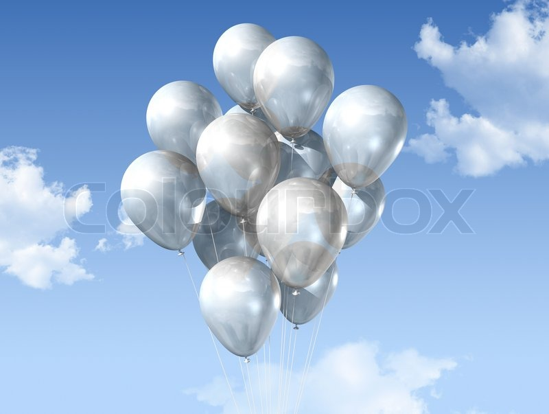 White air balloons floating on a blue sky Stock Photo Colourbox