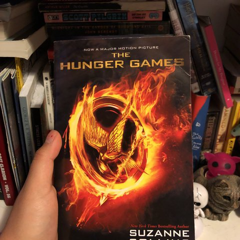 the hunger games book 1 by suzanne collins movie poster / - Depop