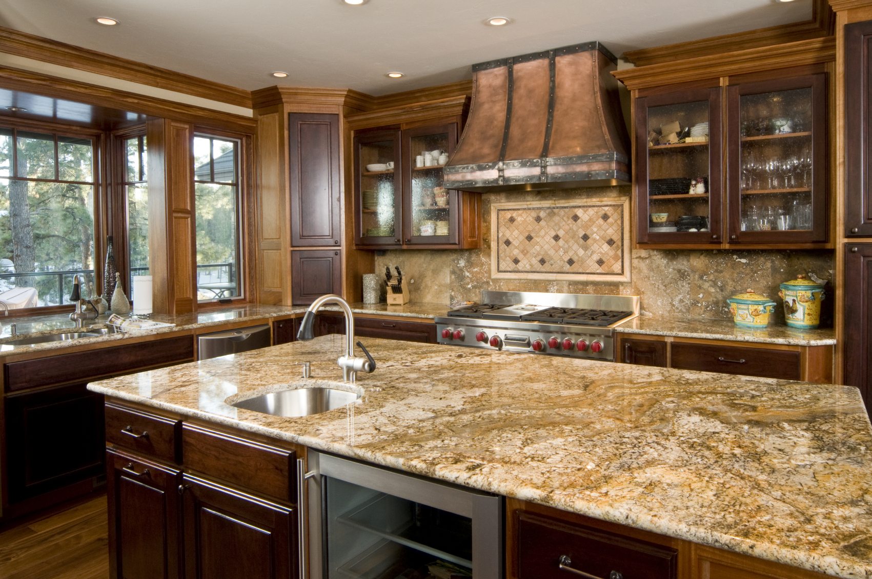 contemporary wood kitchens kitchen counters and backsplash Copper tones unify this kitchen featuring dark wood cupboard doors over lighter toned cabinetry with