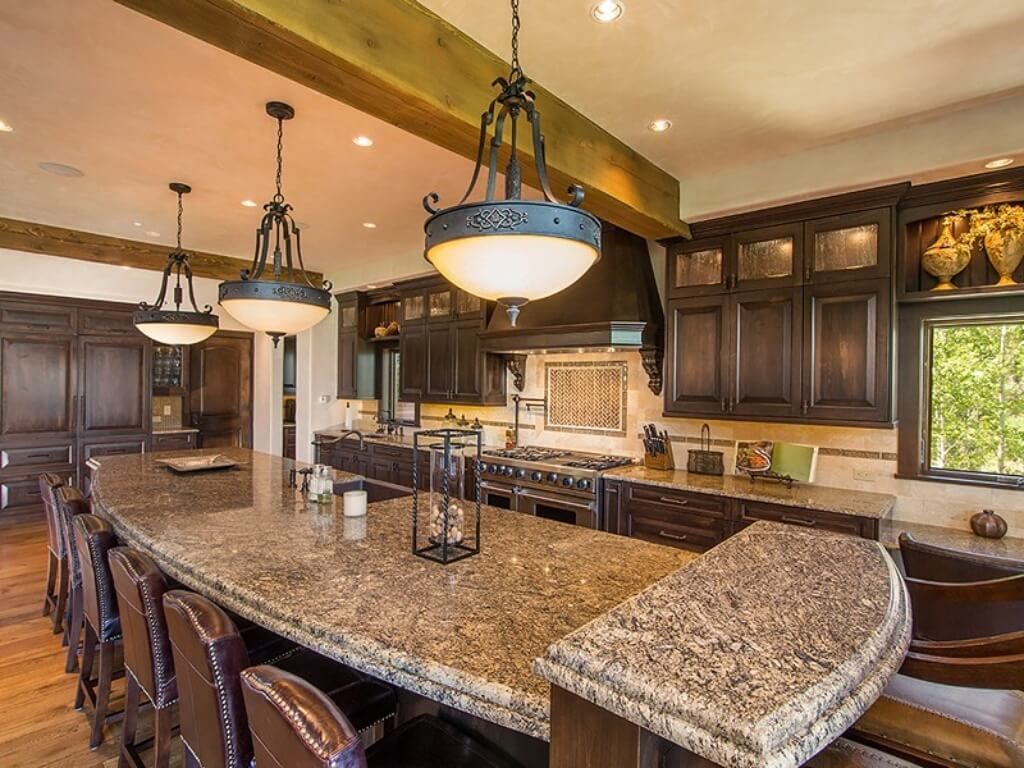 Cheery Open Kitchen Features This Lengthy Island Stone Colorado Ski Chalet Brownmarble Log Seating Room Kitchen Room Remodel Ideas Open Kitchen Room Ideas kitchen Kitchen Great Room Ideas
