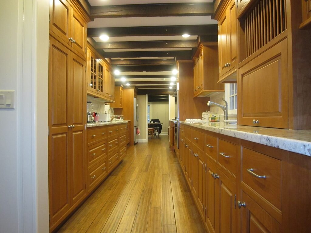 galley kitchen design ideas galley kitchen remodel ideas Light wood toned galley kitchen with nearly matching floor