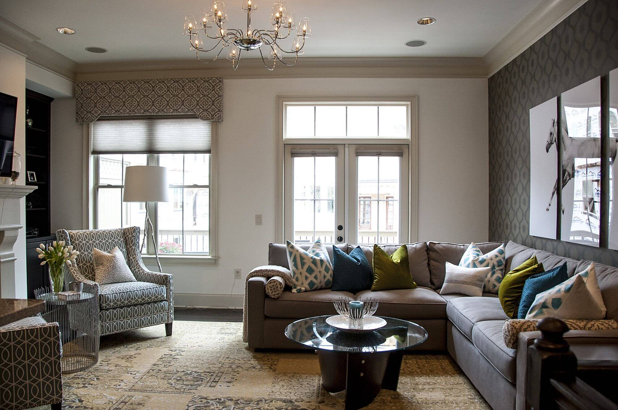 Cozy living room furniture set here includes brown cushion back sectional with variety of patterned color