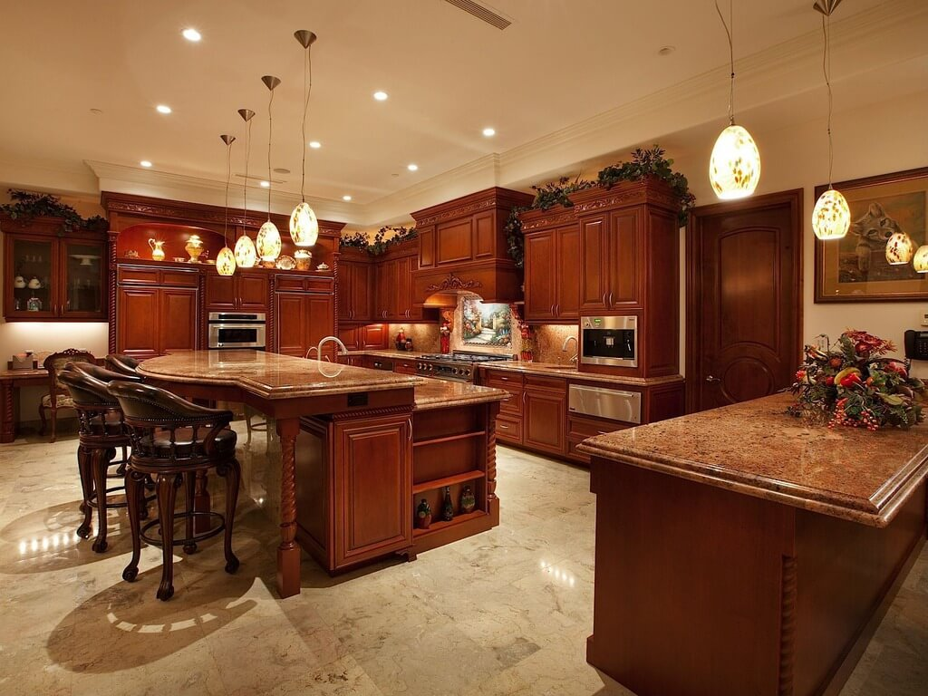 dark kitchen cabinets cabinets for kitchen island Luxurious open kitchen with stained wood cabinetry and large two tier island at