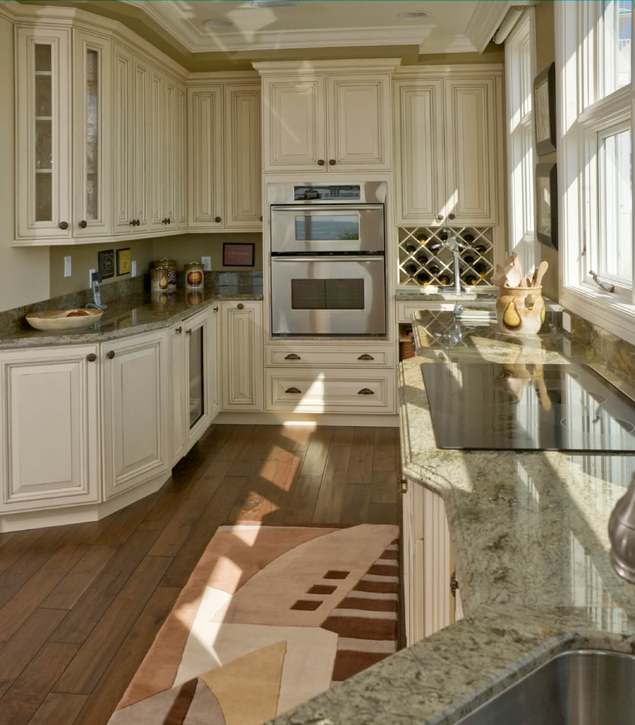 white kitchen designs pictures kitchen countertop tile Treated white cabinets add to the old fashioned look in this compact kitchen featuring geometric rug