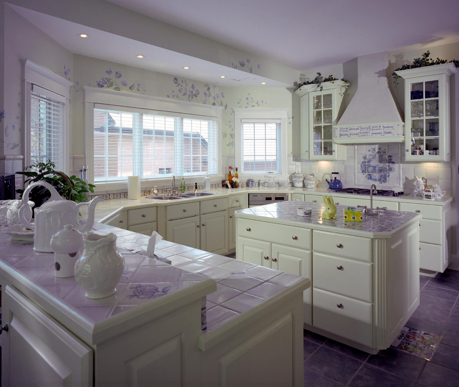 white kitchen designs pictures kitchen countertop tile This white kitchen is enlivened by a smattering of purple throughout purple tile flooring