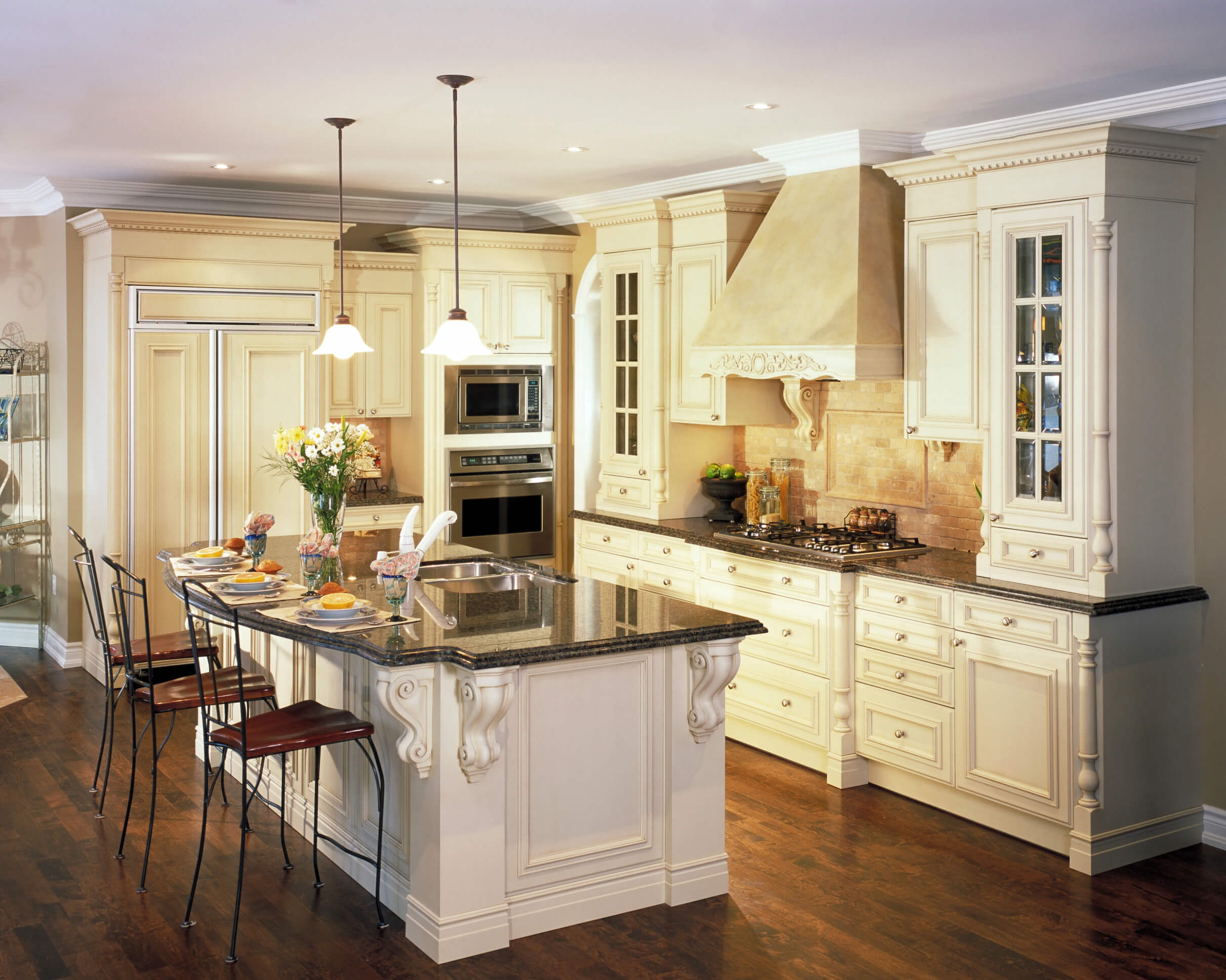 dream kitchen designs cabinets for kitchen island Kitchen featuring great contrast between dark wood flooring white cabinetry and black marble countertops