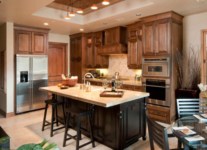 dream kitchen designs cherry wood cabinets kitchen Large black wood and marble topped island commands center of this kitchen flush with dark