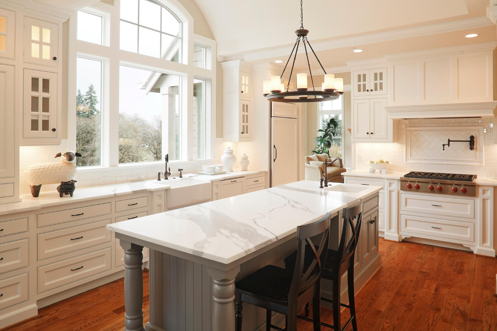 u shaped kitchen designs black kitchen countertops Large ceiling height window affords natural light in this white kitchen centered around large marble topped
