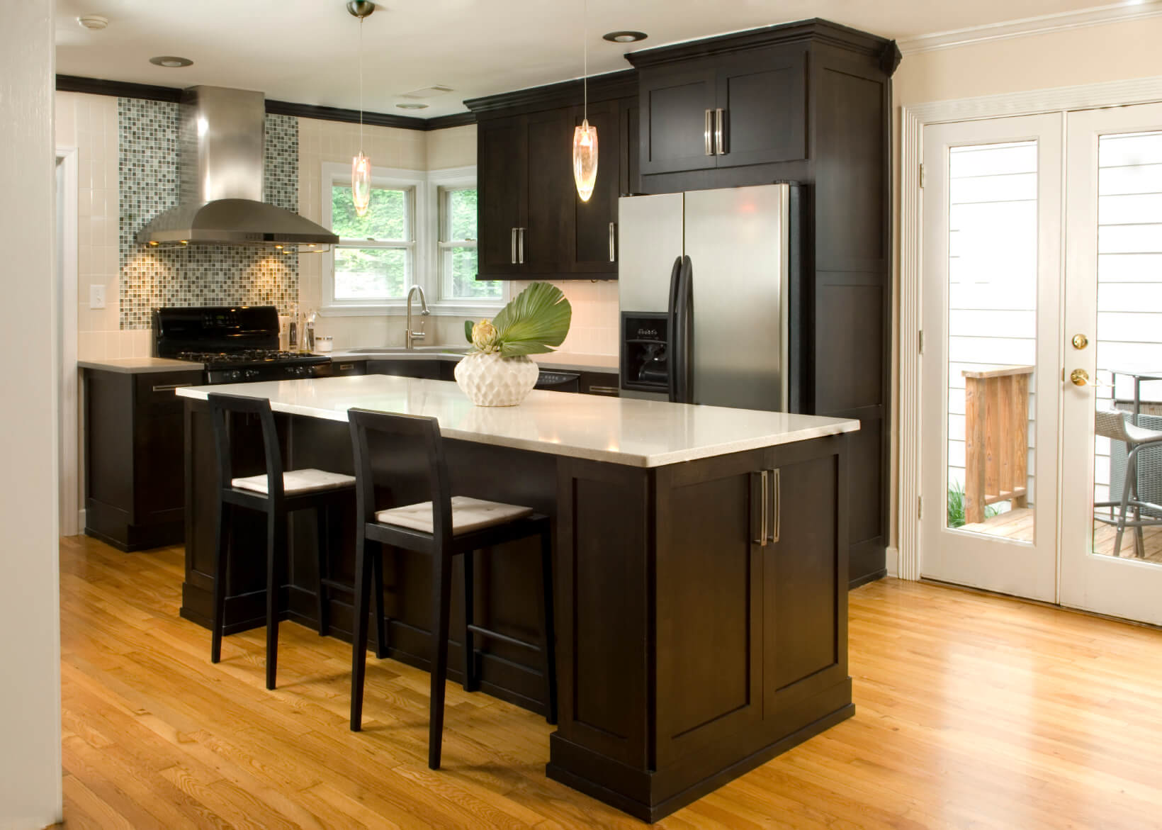 dark kitchen cabinets black kitchen cabinets High contrast white wall kitchen with dark wood paneling and cupboards paired with white countertops