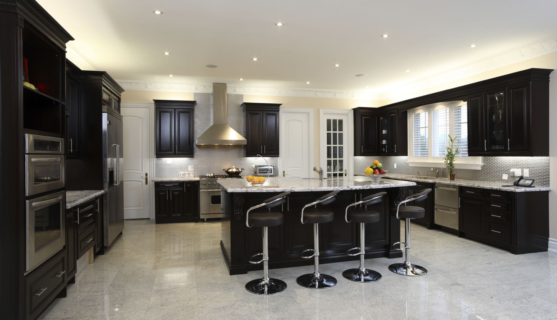 dark kitchen cabinets white kitchen dark floors Spacious modern kitchen with dark cabinetry breakfast bar 4 modern diner style stools and