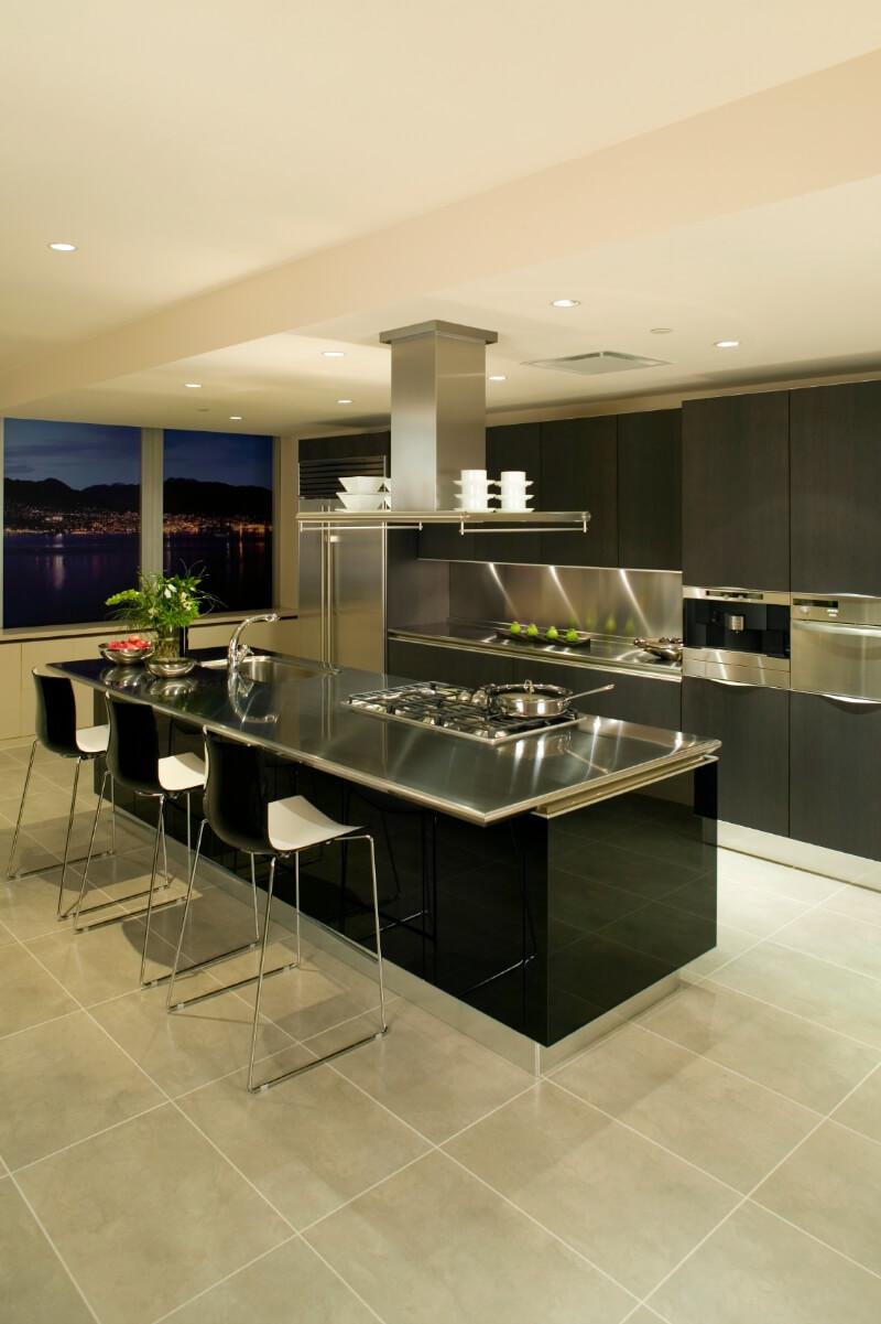 Modern kitchen with black island and dark brown European style cabinets