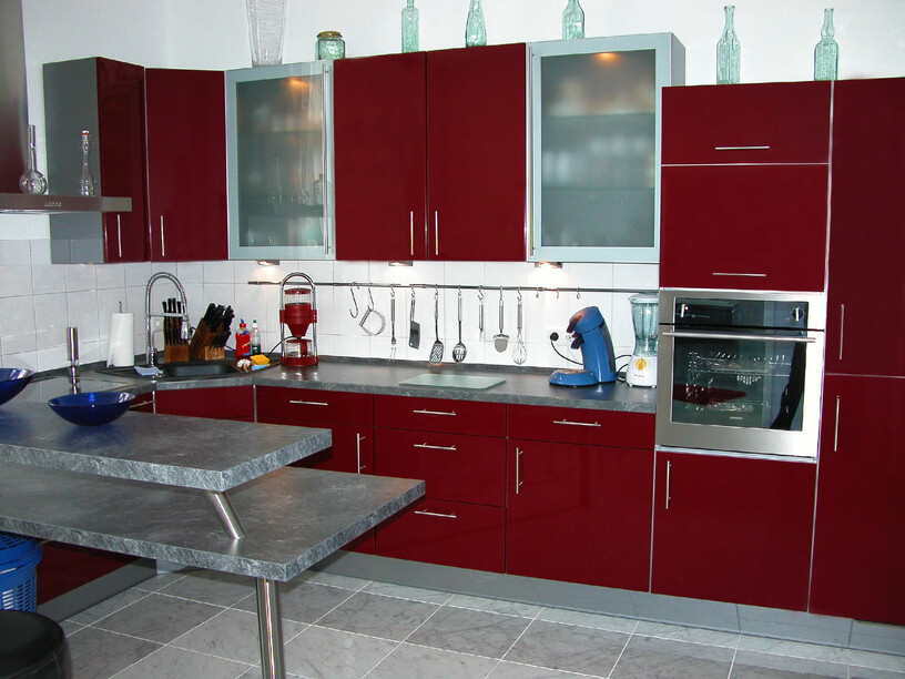 high contrast kitchen features deep red cabinetry paired eat kitchen decor mounting white kitchen cabinetry system european