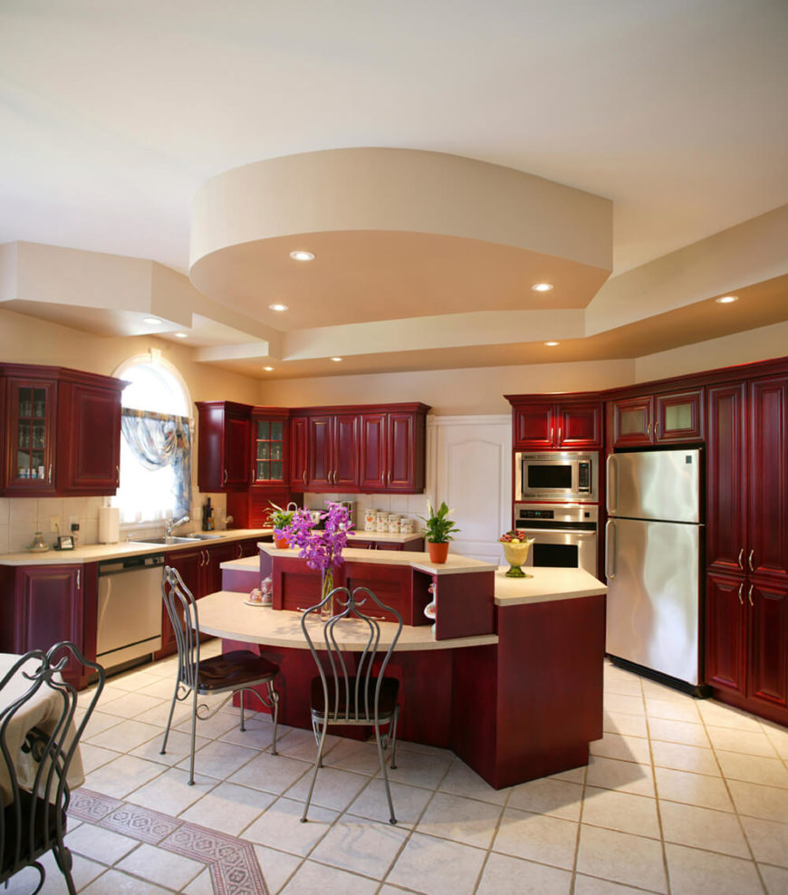 kitchen islands chairs kitchen island chairs Bold red cabinetry is balanced by creamy counters and floors The chairs highlight the stainless