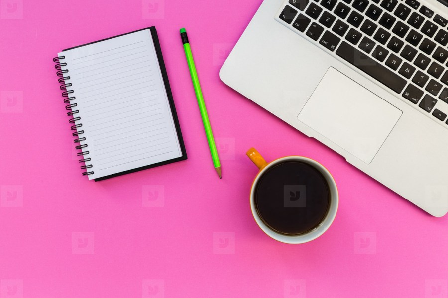 Minimal laptop computer notebook on bright pink background