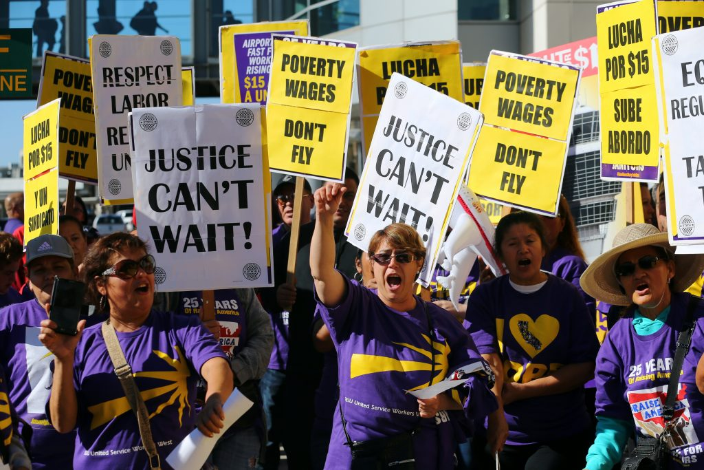 Low-wage workers across the country protest and strike, demanding