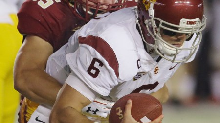 Southern California quarterback Cody Kessler (6) is sacked by Boston College linebacker Christian Lezzer (55) during the first quarter of their  game Saturday, Sept. 13, 2014 in Chestnut Hill. (AP Photo/Stephan Savoia)