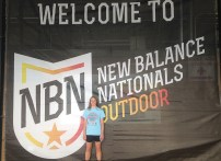 NATIONAL PLACEWINNER Ñ Redbank Valley's Brooke Hinderliter poses in front of the banner at the New Balance Outdoor Nationals held last weekend in Greensboro, N.C. Hinderliter placed sixth in the javelin. (Photo submitted)