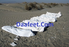 Bodies of illegal Somali immigrants, covered by Medecins Sans Frontieres personnel, lie on a beach in Ahwar