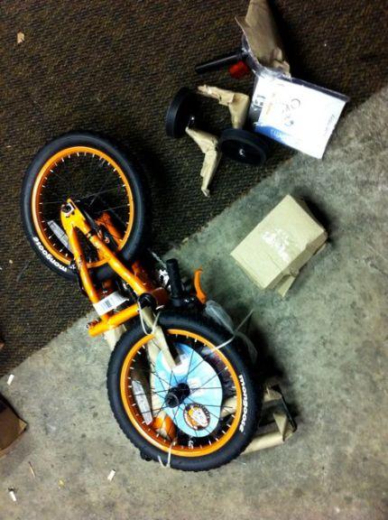 Dad blogger unpacks child bike to assemble
