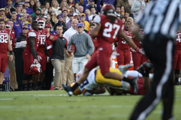 no.80 Landry rolls over a wrestles the ball from the Arkansas DB.