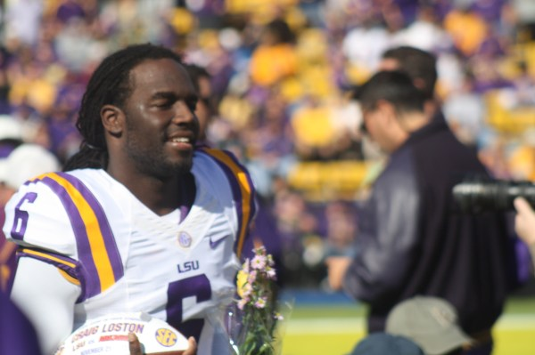 LSU no.6 Craig Loston runs on the field for senior day.