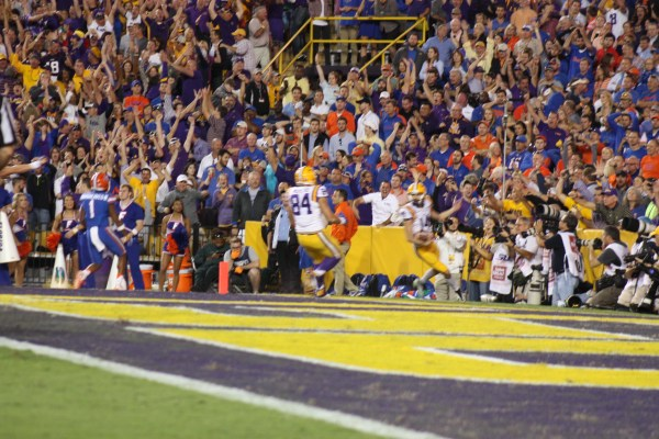 LSU Kicker Domigue scores a td, on a fake kick.