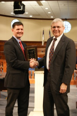 Bryan Peeples stands with Judge Padrick, a Virginia Beach Circuit Court Judge who teaches at the law school and is presenting Peeples with an award for getting the highest grade in his Trial Practice class. March 2018.