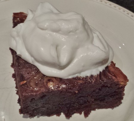 Brownie Topped with Coconut Whipped Cream