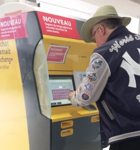 Retrieving Tickets from Train Station Yellow Machine