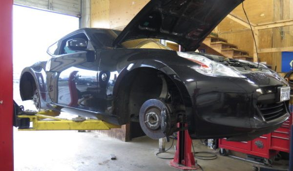 370z with SPC Cambers Arms, track tires and new rotor/pads/dot 4 brake flush at Dales Auto Service