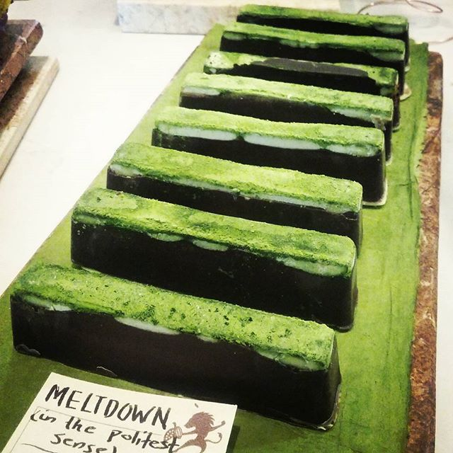 MELTDOWN - a matcha tea candy bar with plum caramel and Tikal ganache. #dlcbonbons #chocolatier #chocolateasart #chocolate #visitmanchesternh #dantachocolate #candybar #matcha #plums