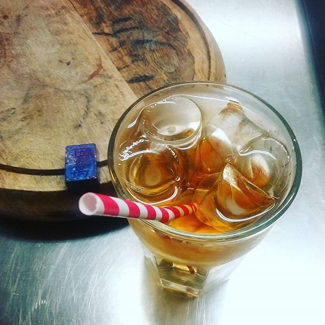 Heritage Beidu ICE TEA, because we can. Beautiful rare Chinese tea leaves from my friend Alice at Red Blossom Tea Company. Served with a blackberry-tangerine caramel bonbon. #icedtea #finetea #redblossomteacompany #manchesternh #dwntnmht #dlcbonbons #foodiefriday