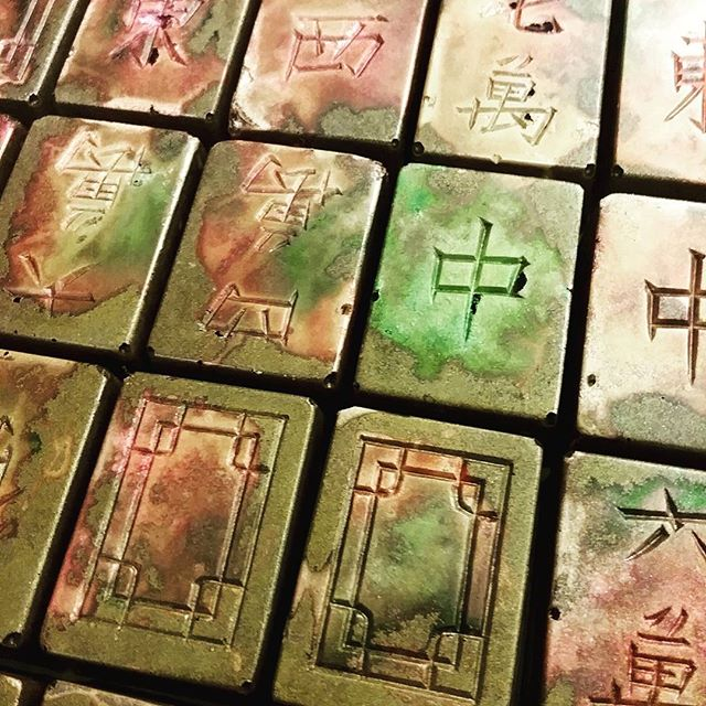 CuPRIS - Italian blood orange, saffron, and peppercorn caramelized ganache. The flavor is in your face and unsubtle. #dlcbonbons #chocolatier #chocolateasart #chocolate #visitmanchesternh #bloodorange #saffron #mahjong #copper