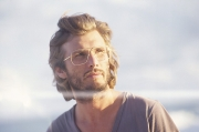 Bearded man with windswept hair wearing Mykita Lite collection, style Kimi in Gold