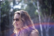Blond woman wearing Mykita Rolf in gold