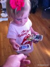 Teaching her early about baseball cards.