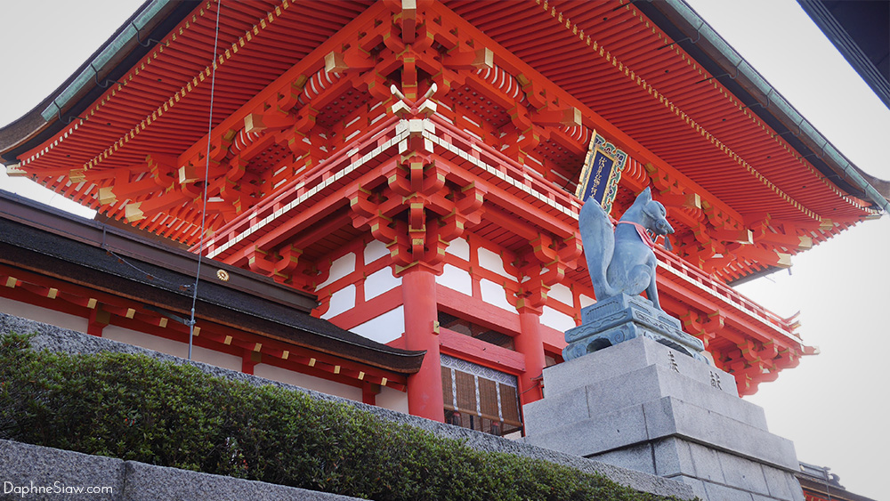 Fox statues and red poles are iconic to Fushimi Inari