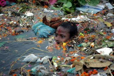 boy in trash river