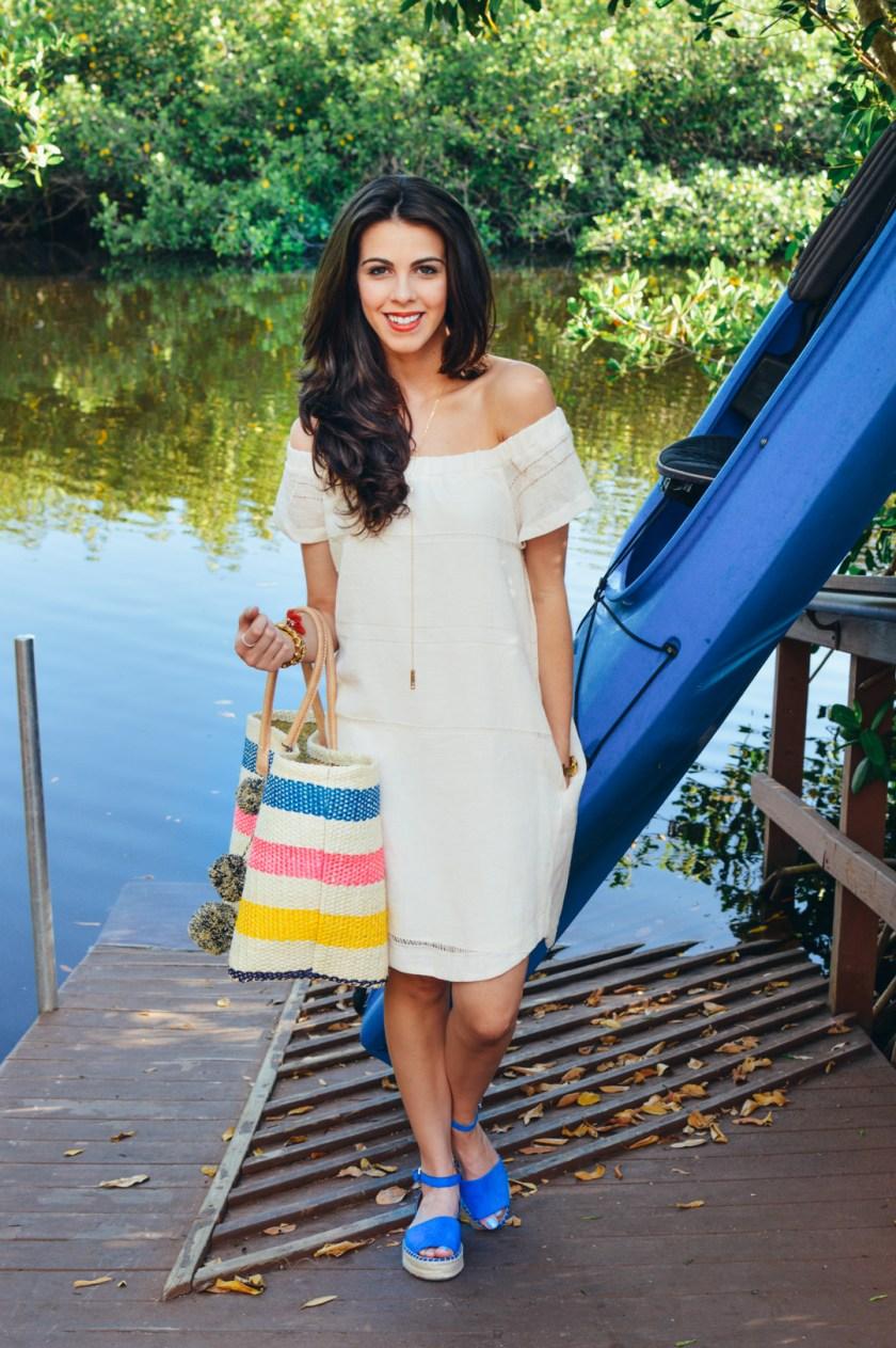 Jackie Roque wearing an off-the-shoulder ASTR dress