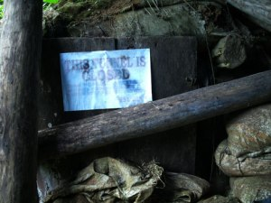 CLOSED. Tunnels owned by small-scale miners are ordered closed by the government following the tragic January landslide in Diat Uno, Napnapan village. (davaotoday.com photo)