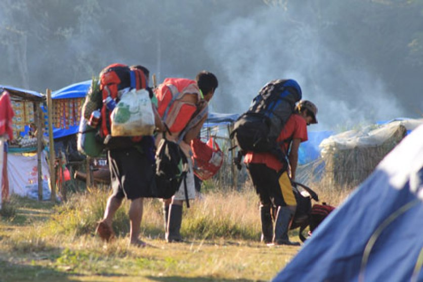GEARING UP. In Lake Venado, a group of porters gear up for the Mt. Apo summit. They loaded 20-25 kilos of stuff in their packs. (davaotoday.com photo by Rawi June Amaga-Morandante)