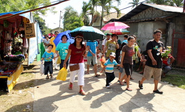 OFF TO THE CEMETERY.  Families troop to the Tibungco Public Cemetery to visit the graves of their loved ones.  (davaotoday.com photo by Medel V. Hernani)