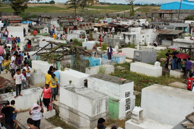 VISITING THE GRAVES.  Families visit their deceased members at the Panacan Public Cemetery.  The land occupied by the cemetery, according to Rowell Gotas, was donated by his great grandfather, Spanish Mariano Osorio in the 1800's.  (davaotoday.com photo by Medel V. Hernani)