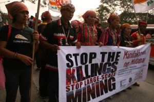 MARCH TO DENR.  Delegates of Manilakbayan (A Journey to Manila) march towards the central office of the Department of Environment and Natural Resources in Quezon City Thursday, December 6.  They called to stop political killings and large-scale mining in Mindanao.   (davaotoday.com photo by Alex D. Lopez)