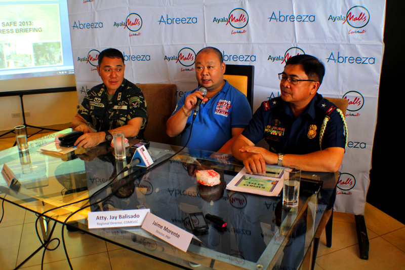 """ALL SET.  Comelec-XI Director lawyer Jay Balisado (middle) says Friday they are """"practically ahead of the timeline"""" when it comes to the preparation for the May 13 elections.  He added 3,501 PCOS machines are already in their custody while official ballots are arriving everyday.  Meanwhile, 10th Infantry Division Maj. Gen. Ariel Bernardo (left) and PNP-XI Chief Superintendent Jaime Morente said at least 90 percent of their personnel will be deployed """"to maintain maximum security alertness"""" for the elections.  (davaotoday.com photo by Ace R. Morandante)"""